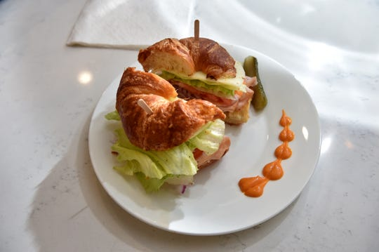 The menu at Dolce Vita cafe in the Oxnard Transit Center includes made-to-order croissant sandwiches for $4.99. Owner Yong Tae Kwon serves for-here orders on plates garnished with chipotle mayo.