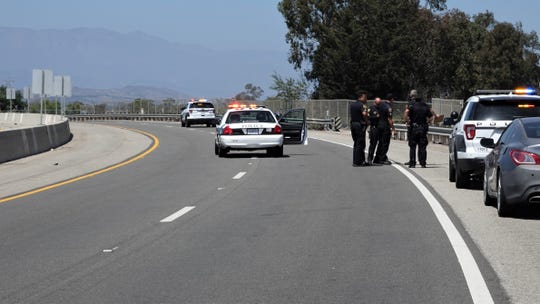 Authorities on July 20, 2019, investigate a motorcycle crash that killed one person on Victoria Avenue north of Gum Tree Street in Oxnard.