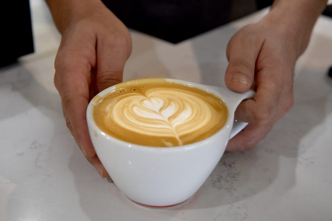 """Yong Tae Kwon, owner of Dolce Vita cafe inside the Oxnard Transit Center, taught himself how to make specialty coffee drinks by watching YouTube videos. """"I'm still practicing. I did artwork when I was younger, but latte art is different,"""" he says."""