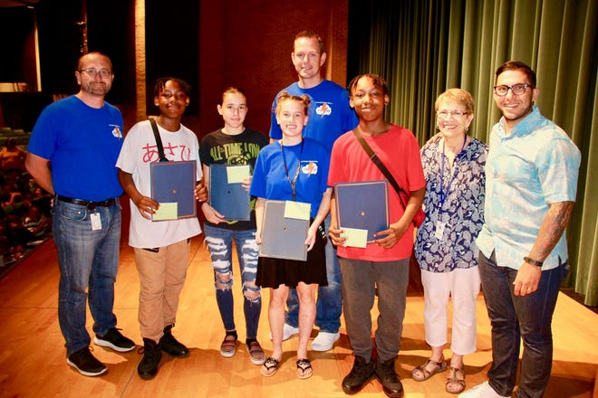 "Four eighth-grade students from Lakeside Middle School recently received ""The Good Kid Award"" from Barbara Westog and Donna Pio, education co-chairs, Millville Woman's Club. The award included a certificate and a $50 Visa gift card. (Front row, from left) Spike Cook, principal, Lakeside; award recipients Rashon Butler, Madison Hannah, Tifani Groover and Ramir Butler; Westog; Anthony Procopio, school guidance counselor; and (back row) Ryan Hudson, vice principal; are pictured at the award presentation."