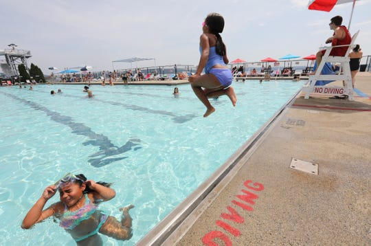 Ella Geotz, 6, from West Haverstraw, right, jumps into the poll as sister Camille, 7, left, prepares for the splash at Bowline Point Park in Haverstraw on Saturday, July 20, 2019.