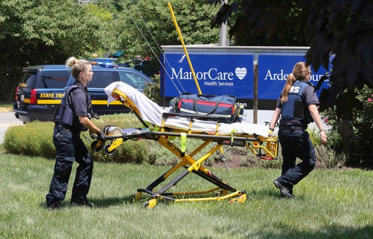 A gurney is wheeled to the front of the ManorCare Health Services facility at 700 Foulk Road after a shooting was reported there about 1:10 p.m. Saturday.