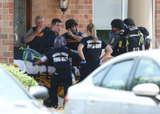 EMTS and paramedics stage at the entrance to the ManorCare Health Services facility at 700 Foulk Road after a shooting was reported about 1:10 p.m. Saturday.