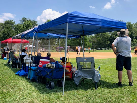 Tents were aplenty at the Midway softball fields Saturday morning as temperatures approached triple digits.
