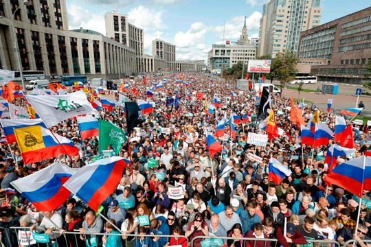 Demonstrators take part in a rally on July 20, 2019, in Moscow to support opposition and independent candidates after authorities refused to register them for September elections to the Moscow City Duma.