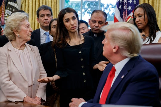 President Donald Trump listens to Nobel Peace Prize recipient Nadia Murad, a Yazidi from Iraq, center, as he meets with survivors of religious persecution in the Oval Office of the White House on Wednesday, July 17, 2019, in Washington. (AP Photo/Alex Brandon)