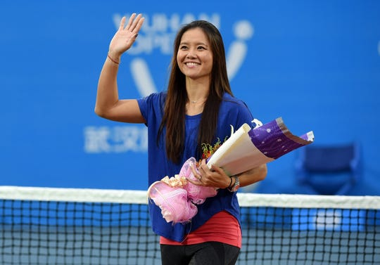 Li Na waves to the crowd during a ceremony marking her retirement at the Wuhan Open in China on Sept. 23, 2014.
