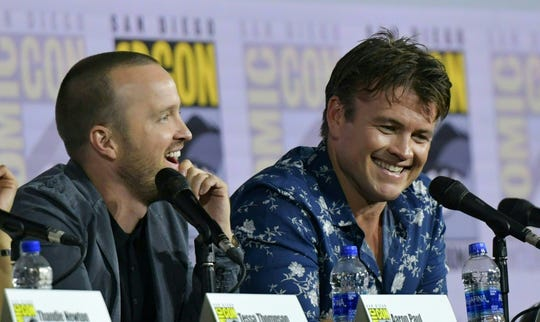 """Aaron Paul (left) shares a laugh with co-star Luke Hemsworth during the """"Westworld"""" Comic-Con panel."""