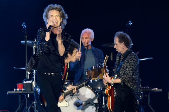 Mick Jagger performs, backed by by Ronnie Wood on guitar, drummer Charlie Watts and Keith Richards on guitar during Friday night's concert in Jacksonville, Fla., Friday, July 19, 2019.
