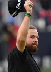 Shane Lowry salutes the crowd after completing his third round Saturday.
