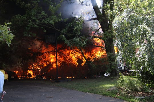 A fire that spread to two houses and a recreational vehicle between the homes, created a dangerous situation for firefighters and other first responders on Apple Valley Drive in the Belford section of Middletown on Saturday morning.