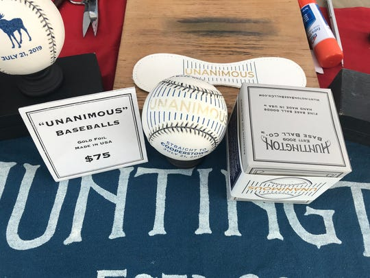 William Peebles said his self-made UNANIMOUS baseballs have been selling well this weekend in Cooperstown.