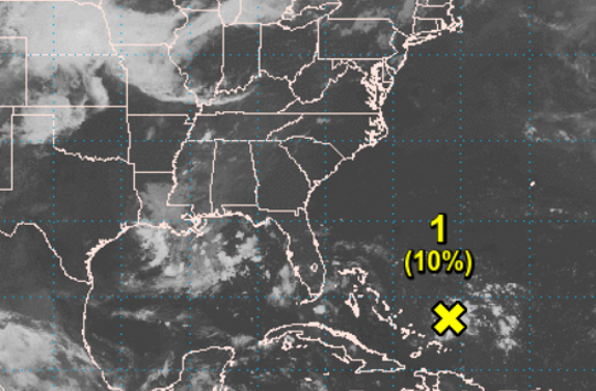 The National Hurricane Center is monitoring a tropical wave hundreds of miles east of the central Bahamas.