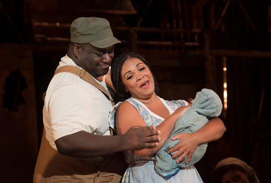"Jake (Reginald Smith, Jr.) and Clara (Janai Brugger) sing to their baby in Cincinnati Opera's production of ""Porgy and Bess."" The production runs through July 28 at Music Hall."