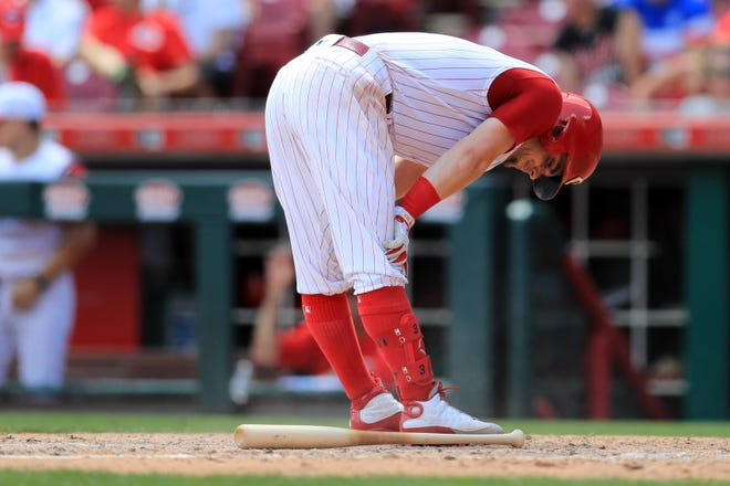 Jul 21, 2019; Cincinnati, OH, USA; Cincinnati Reds second baseman Scooter Gennett (3) reacts to striking out with the bases loaded to end the inning against the St. Louis Cardinals in the fifth inning at Great American Ball Park.