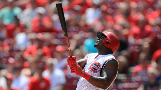 Jul 21, 2019; Cincinnati, OH, USA; Cincinnati Reds right fielder Yasiel Puig (66) reacts as he hits a fly ball for an out with the bases loaded against the St. Louis Cardinals in the fifth inning at Great American Ball Park.