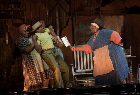 "Maria (La'Shelle Allen, right) is the owner of Catfish Row's cookshop. As fearless as she is stubborn, she threatens a smalltime drug dealer named Sportin' Life (Frederick Ballentine, Jr.) in Cincinnati Opera's production of ""Porgy and Bess."""