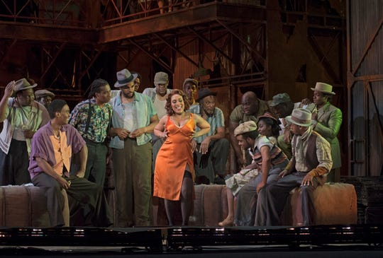 "Talise Trevigne (center) sings the role of Bess in Cincinnati Opera's production of ""Porgy and Bess."" Performances continue through July 28 at Music Hall."