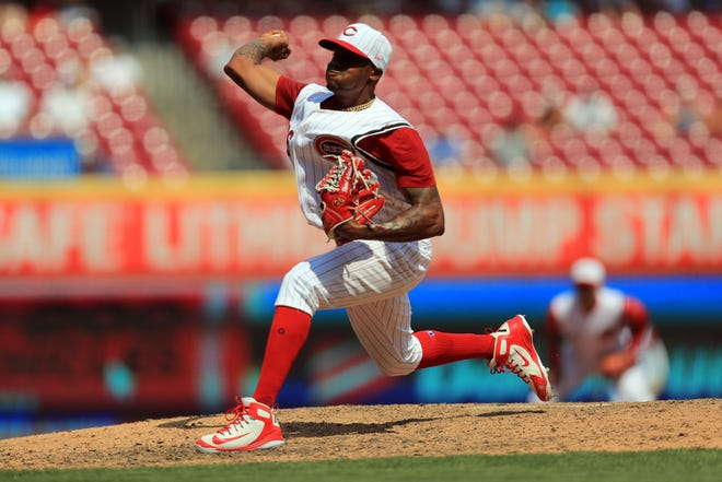 Jul 21, 2019; Cincinnati, OH, USA; Cincinnati Reds relief pitcher Raisel Iglesias (26) throws against the St. Louis Cardinals in the ninth inning at Great American Ball Park.