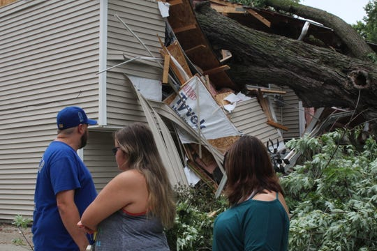 Despite the damage, Tim Hall and Arianne Hall-Bernard are grateful that their daughter and nephew decided to go to their grandma's the night of the storm. Bernard-Hall said they would have been sitting on a couch where part of a tree now rests after falling through their home Saturday, July 20, 2019, as storms blew through the area.