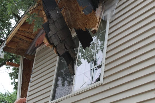 Arianne Hall-Bernard said she has a list of things to look for and check the condition of when she is able to re-enter the south-side Des Moines home, including her daughter's stuffed animals, her prayer table and molds of their hands. A tree fell through the home Saturday, July 20, 2019, as storms moved through the area.