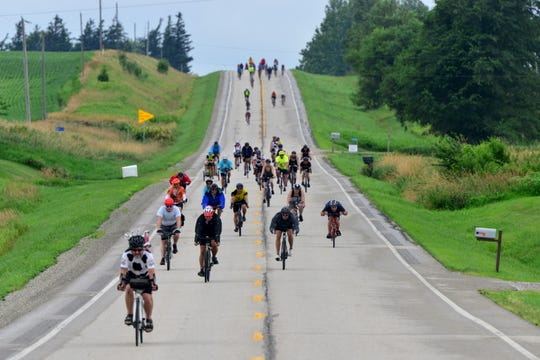 Riders on the first day of RAGBRAI make their way outside of Marne on Sunday July 21, 2019.