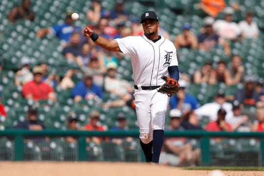 Tigers third baseman Jeimer Candelario makes a throw to first base for an out during the 10th inning of the Tigers' 4-3 win in 10 innings on Sunday, July 21, 2019, at Comerica Park.