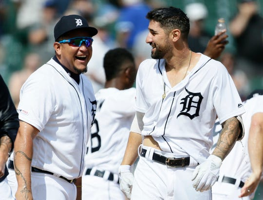 Tigers DH Miguel Cabrera laughs after Nicholas Castellanos was drenched with water after hitting a walk-off home run in the Tigers' 4-3 win in 10 innings on Sunday, July 21, 2019, at Comerica Park.