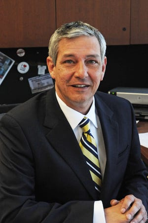 Thomas Darling has been terminated as Troy's former financial services director