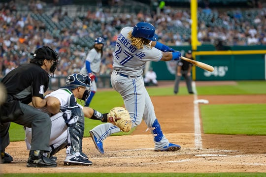 Toronto Blue Jays' Vladimir Guerrero Jr. hits a grand slam home run in the fifth inning against the Detroit Tigers at Comerica Park on July 20, 2019.