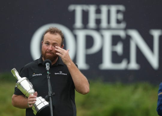 Shane Lowry wipes away a tear as he makes a speech holding the Claret Jug trophy after winning the British Open.
