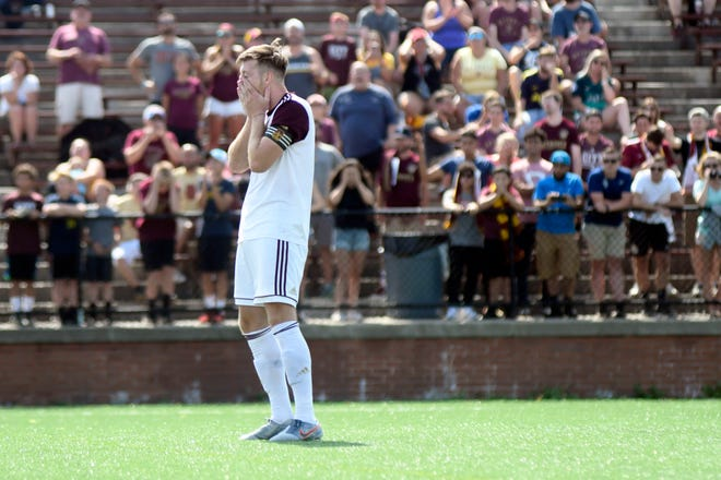 Detroit City FC's Stephen Carroll reacts after missing his penalty shot against Cleveland SC.