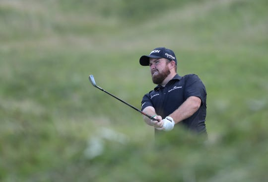 Shane Lowry chips onto the fifth green during the third round of the British Open.