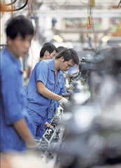 SAIC Motor Corp., GM's and Volkswagen's biggest auto-making partner in China, expects annual sales to fall.