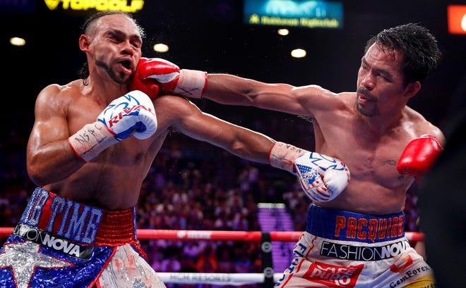 Manny Pacquiao, right, lands a punch against Keith Thurman in the 10th round of a welterweight title fight Saturday in Las Vegas.