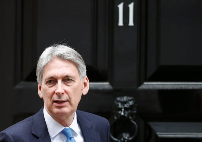In this Wednesday, Jan 9, 2019 file photo, Britain's Chancellor of the Exchequer Philip Hammond leaves 11 Downing Street for the House of Commons to attend Prime Minister's question time, in London.