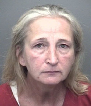 Wendy Payne, 51, was charged with murder Sunday after deputies arrived to her residence and found her husband dead.