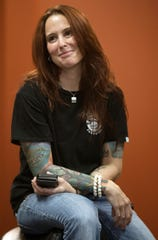 Amy Dimon leads a fundraising event on Sunday in support of Saluscare at Altered Tattoo Company in south Fort Myers. Supporters received apple tattoos. Saluscare offers behavioral healthcare services in Southwest Florida. The next opportunity to support the effort is on July 24 from 12 p.m. to 6 p.m. Go to news-press.com to learn more.