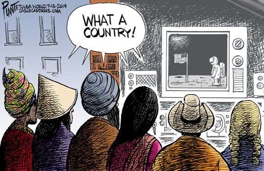 The world watches the moon landing.