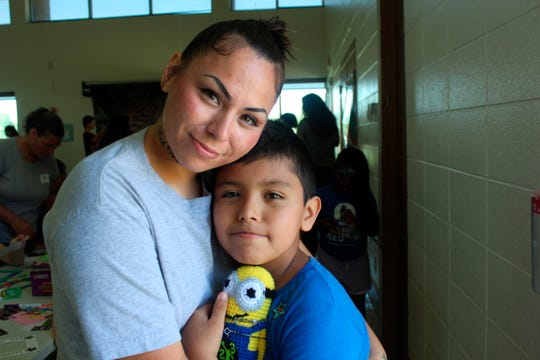 In this June 2019 photo, Inmate Feleesha Bruette embraces her son Zahkais as they participate in Camp Reunite, at Taycheedah Correctional Institution in Fond du Lac, Wis. Now in its second year, the week-long Camp Reunite partnered with Taycheedah in June to provide a bonding opportunity for children and mothers and a fun, healing camping experience for the kids.