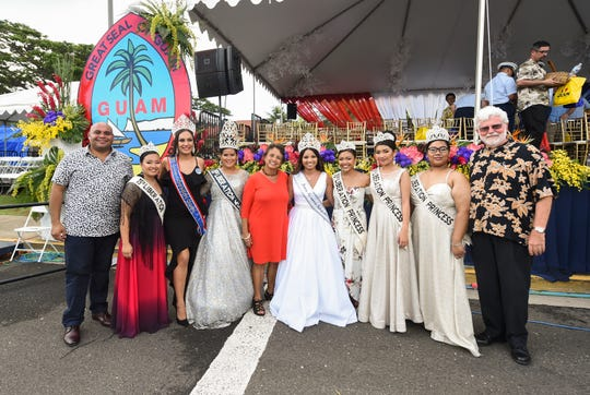 Dignitaries gather for a photo with the 75th Liberation Queen and her royal court following the 75th Liberation Day Parade in Hagåtña, July 21, 2019. From left: Lt. Gov. Josh Tenorio, Liberation Princess Letayah G. Cave, Lorin Rose Lentsch, 2019 Guam Liberation Queen Las Vegas, Liberation Queen Regina Duenas,  Gov. Lou Leon Guerrero, Ke'nanne Balajadia, Sons & Daughters of Guam Club, Inc. 2019 Liberation Queen, Liberation Princess Maya Jae Reyes, Liberation Princess Cianna Salonga, and Liberation Princess Kaitlyn Michelle Gogue.