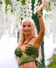 Actress and singer Pia Mia Perez waves to spectators during the 75th Liberation Parade in Hagåtña on July 21, 2019.