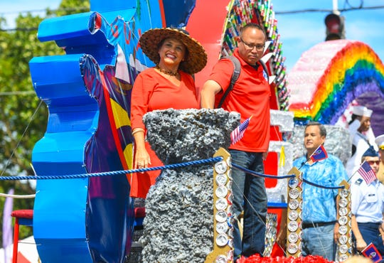 Gov. Lou Leon Guerrero arrives to the main grandstand aboard her float during the 75th Liberation Parade on July 21, 2019.