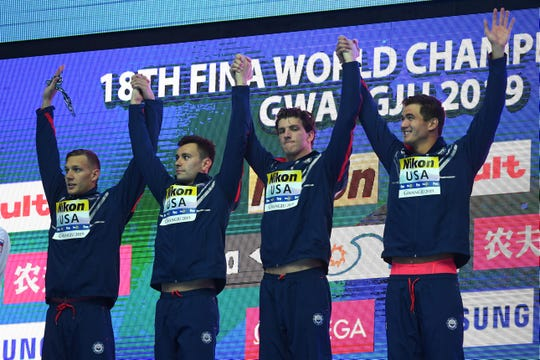 Gold medalists Team USA (LCaeleb Dressel, Blake Pieroni, Zach Apple and Nathan Adrian pose during the medal ceremony for the Men's 4x100m Freestyle Final on day one of the Gwangju 2019 FINA World Championships at Nambu International Aquatics Centre on July 21, 2019 in Gwangju, South Korea.