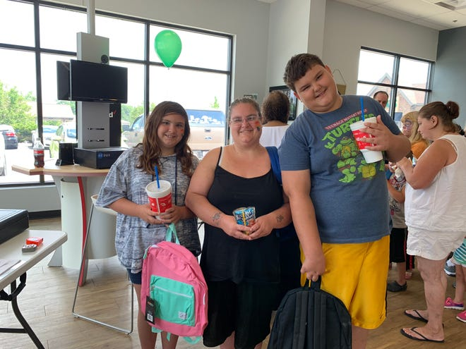 From left, Makayla Brinker, Rachel Kehl and Gabe Brinker. Makayla and Gabe received backpacks ahead of the upcoming school year at the eighth annual School Rocks Backpack Giveaway at the Verizon Wireless store on Lexington Road.