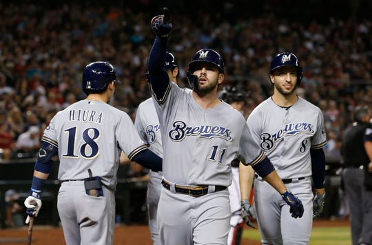 Mike Moustakas points to someone ni the stands after his three-run homer in the eighth inning against the Diamondbacks gave the Brewers the lead.