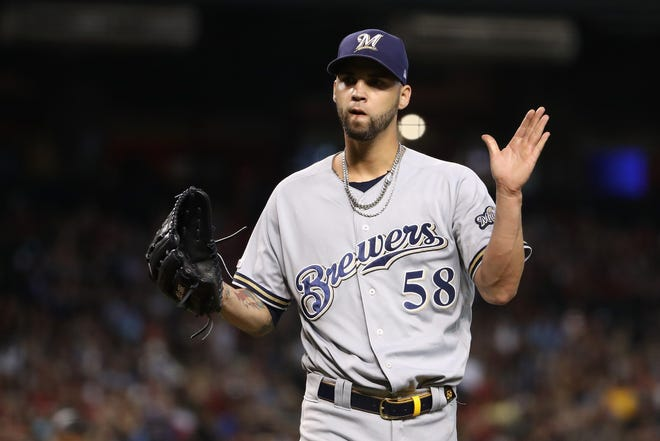 Brewers reliever Alex Claudio reacts after getting out of a bases-loaded jam against the Diamondabcks in the sixth inning unscathed.