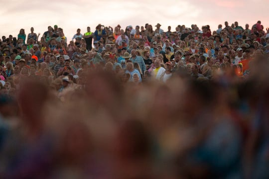 Concert goers watch as Jimmy Buffett and the Coral Reefer Band's performs at Alpine Valley Music Theatre on Saturday, July 20, 2019.