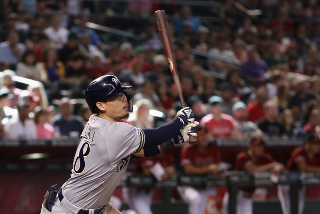 Keston Hiura gets the Brewers going during their decisive three-run rally in the eighth inning against Arizona with a triple down the right-field line.