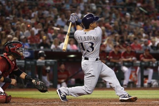 Tyler Saladino of the Brewers blasts a grand slam off Diamondbacks starting pitcher Alex Young during the fourth inning.